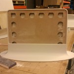 Plywood and MDF support a Corian base for mirrors (courtesy Associated Fabrication)