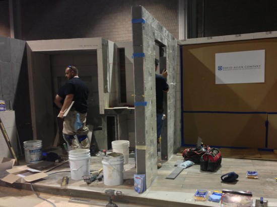 The David Allen Company works to install tile at the In-patient Room in a Women's Birthing Center on Day 1 at Coverings. (Emily Hooper/AN)