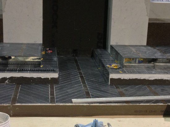 On Day 1, glass tile installed on treads complements mirrored and beveled subway tile insets from Artistic Tile. (Emily Hooper/AN)