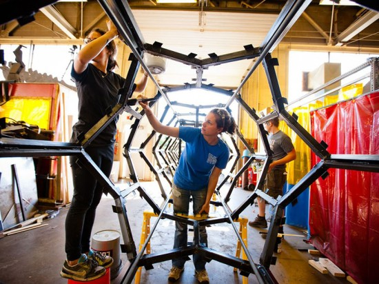 The design team works on the steel frame at UB's School of Architecture and Planning workshop. (Doug Lever/University at Buffalo)