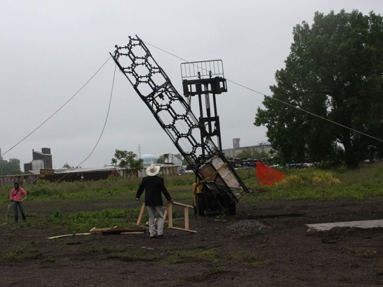 The team erects the steel frame on-site, overseen by Rigidized Metals' Rick Smith.  (Hive City Design Team)