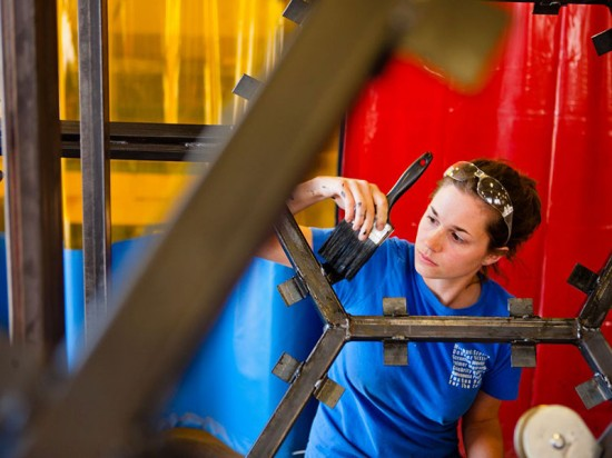 Designer Courtney Creenan works on the elevator's steel frame. (Doug Levere/University at Buffalo)
