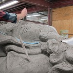 Sculptors smooth the angel's surface by hand. (Mitchell Bring/Boston Valley Terra Cotta)