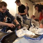 Diles and KSA students tape the mold together. (Phil Arnold)
