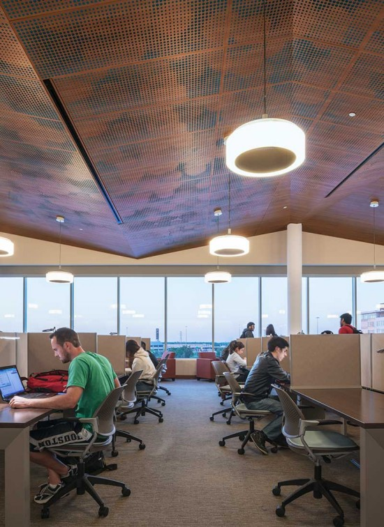 Ample space between the dropped ceiling and the planchement absorbs vibrations in a lightweight system. (Ryan Gobuty/Gensler)