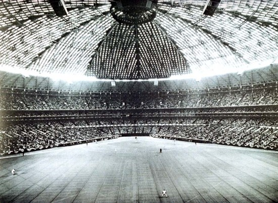 The Astrodome's structure encloses so much volume that its roof provides no surrogate scale or visual weight. As experienced by visitors, the Dome's roof is a gossamer web of steel clouds drifting above the playing field, completing a vision of the cosmos and creating a new relationship between the players and the audience in the public ritual of sports. (Courtesy Texas Architect)