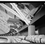 Steel truss tension ring supporting dome roof covered by architectural finish. Tension ring roller support at column obscured by column coverings. (Jet Lowe, Courtesy Library of Congress)