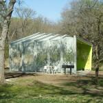 The pavilion in its woodland setting. (Courtesy Architexas)