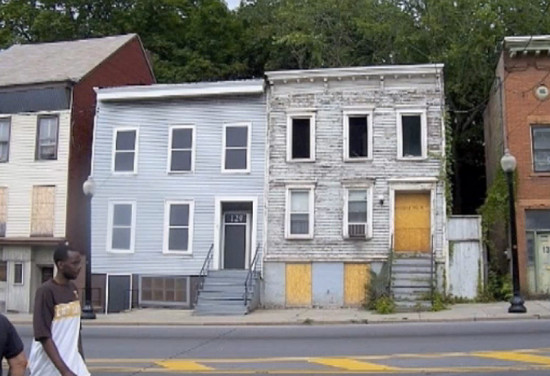 Toepfer's boarded windows on the left. (Video still / Courtesy Medill Reports)