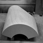 The irregular shape of each section required custom cutouts for the walnut veneer. (courtesy Skylab Architecture)