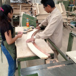 Craftsmen compare the MDF template to the final wooden rib. (courtesy Rojkind Arquitectos)