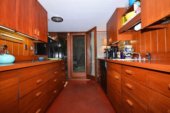 The kitchen has retained its original finishes. (Larry Metz)
