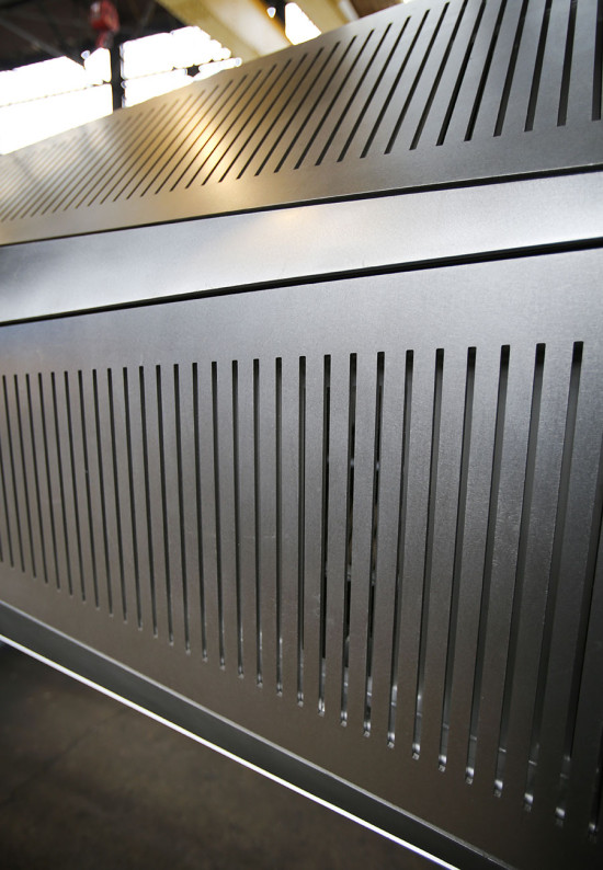Slots were laser cut to allow for air-cooling mechanical systems. (courtesy Kammetal)