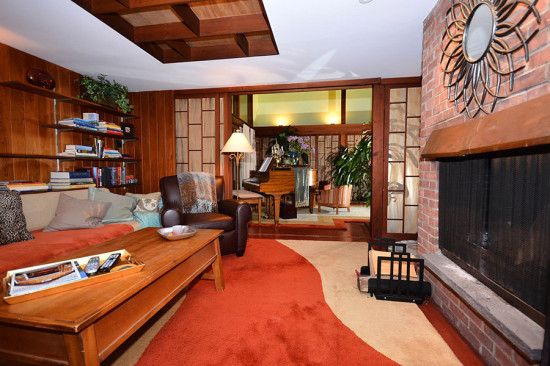 A family retains an original brick fireplace. (Larry Metz)