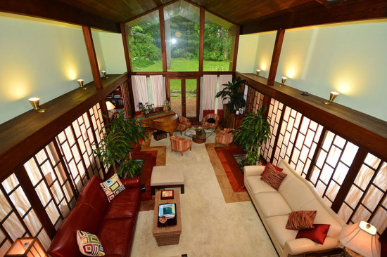 The home's great room features a double-height ceiling. (Larry Metz)