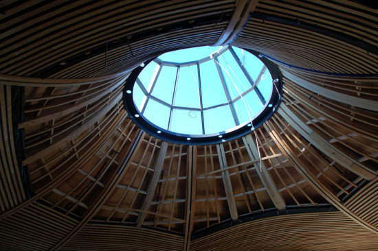 Each of the wooden panels houses sprinkler pipes and heads, electrical conduits, and light fixtures. (Stephen Pasche)