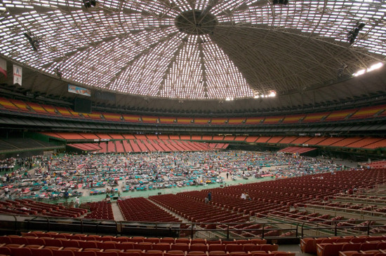 Inside the Houston Astrodome in 2005 when it houses Hurricane Katrina survivors. (Kelly Garbato / Flickr)
