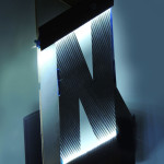 Laser-cut stainless steel lettering is back lit with LEDs. (courtesy Situ Studio)