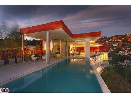 The home, repaired after the fire, sits in the Hollywood Hills (MLS)