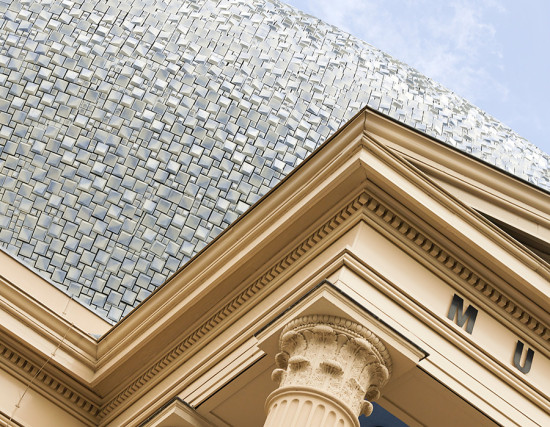 More than 50,000 custom ceramic tiles clad a double height addition. (Joep Jacobs)
