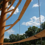 The timber framing and ½-inch steel cables hang from a structural steel top truss. (Stephen Pasche)