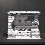 A model of Ensamble Studios bus stop of stacked wooden planks (Courtesy kulturkrumbach)