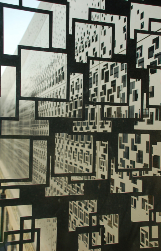 The pattern varies in opacity to correspond with interior programming. (Calvin Chua)