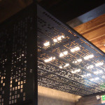 The canopy hangs below and independently from the lighting. (courtesy Chris French Metal)