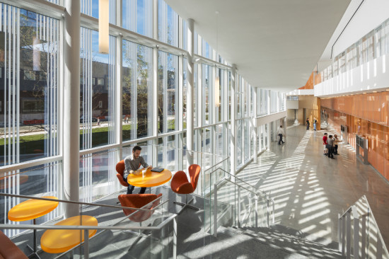 MULTIPLE LAYERS OF GLASS BALANCE VISIBILITY AND PRIVACY IN THE BUILDING'S PUBLIC SPACES, OFFICES, AND LABORATORIES (ALBERT VECERKA/ESTO)