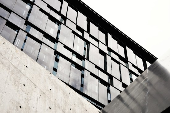 METAL PANELS AND TEXTURED STONE COMPLETE THE FACADE (ZGF ARCHITECTS LLP)