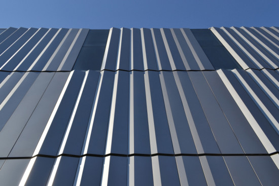 CORRUGATED METAL PANELS MAKE UP NEARLY TWO-THIRDS OF THE BUILDING'S FACADE (ALBERT VECERKA/ESTO)