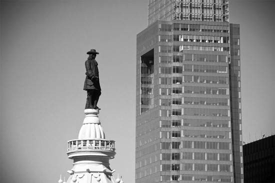 William Penn atop City Hall with the Comcast Center in the background. (thisisbossi / Flickr)