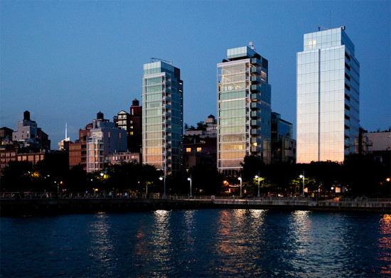 Three glass residential towers stand along Manhattan's West Street at dusk. (Dan Nguyen / Flickr)