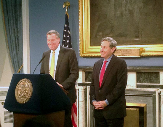 New York City Mayor Bill de Blasio introduces Carl Weisbrod as the new City Planning Commissioner. (Kyle Kimball / Twitter)