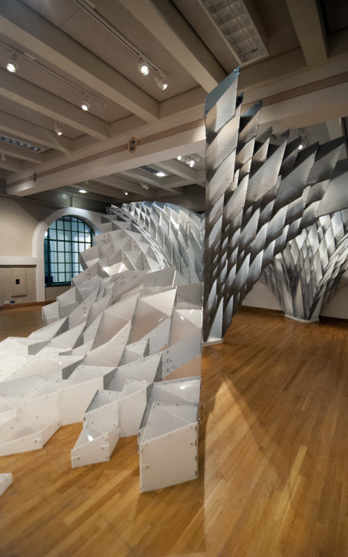 The installation features a central catenary vault with two vaults to either side, plus a cascading front face. (Kory Bieg)