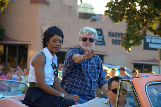 With his wife Mellody Hobson, who heads a Chicago investment firm, film mogul George Lucas serves as Grand Marshall of the 2013 Modesto American Graffiti Car Show and Festival parade. (hharryus / Flickr)