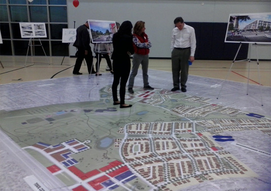 Attendees walk through a map of the proposal (Courtesy Colony Park Sustainable Community Initiative)
