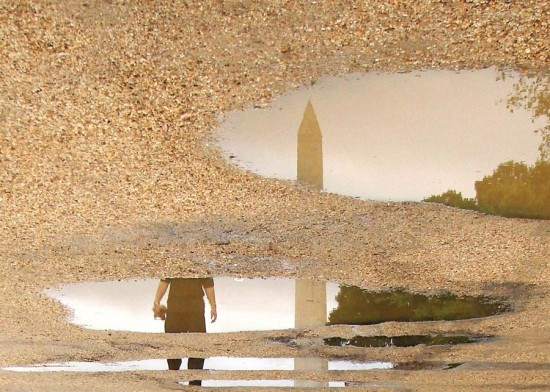 The Washington Monument reflected in a puddle. (Zach Stern / Flickr)