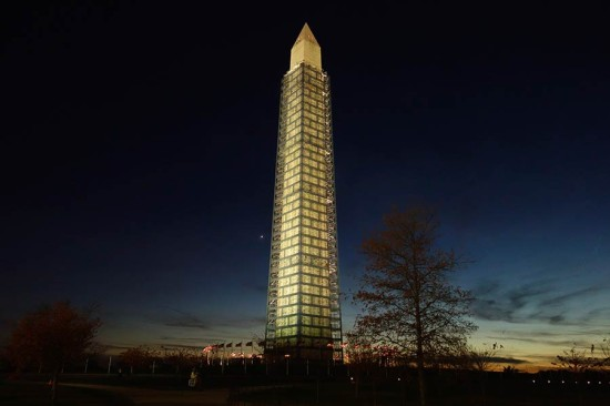 The Washington Monument begins to emerge from its scaffolding cocoon in November 2013. (John Sonderman / Flickr)