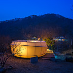 At night, the structures glow from within. (Courtesy ArchiWorkshop)