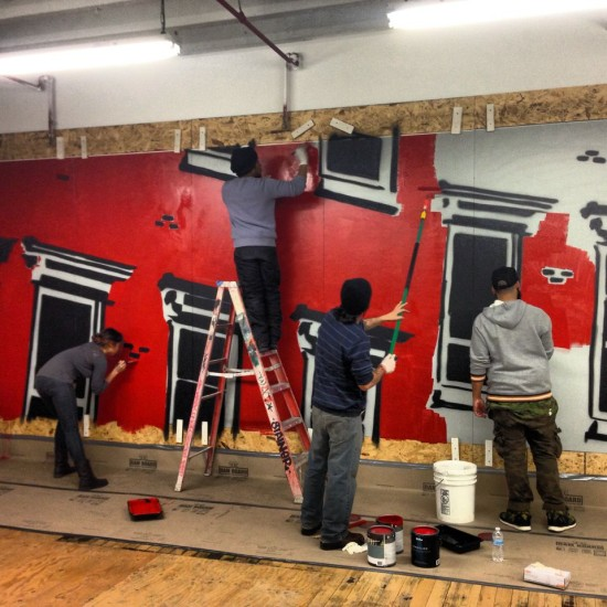 The team working on the mural in Sunset Park.