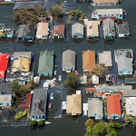 New Orleans, Louisiana, September 4, 2005. Flooding on Claiborne and Desire Streets was slow to dissipate after levees failed during Hurricane Katrina, causing billions in damages. (Federal Emergency Management Agency Photo Library; photo Liz Roll)
