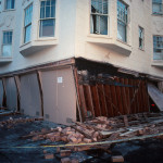 San Francisco, California, October 17, 1989. The damage to the weak, unreinforced garage level of this building at the corner of Beach and Divisadero was typical of the failures seen in the Marina District after the Loma Prieta Earthquake. (U.S. Geological Survey, J.K. Nakata)