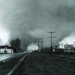Twin funnel clouds over, Elkhart, Indiana, April 11, 1965. Following this deadly Palm Sunday Tornado Outbreak, NOAA's National Weather Service improved its severe weather forecasts and warning systems, establishing the Watch and Warning Program and the weather spotter program, SKYWARN. (NOAA, National Weather Service Collection)
