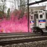 Drama Wall and a passing train. (Courtesy Steve Weinik for the City of Philadelphia Mural Arts Program)