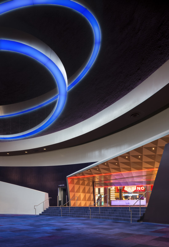 The theater's lobby features an asymmetrical portal and an abstract LED chandelier. (Ryan Gobuty for Gensler)