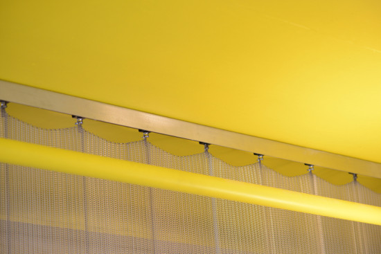 The 500-pound divider hangs from an aluminum track. (Courtesy Cambridge Architectural)