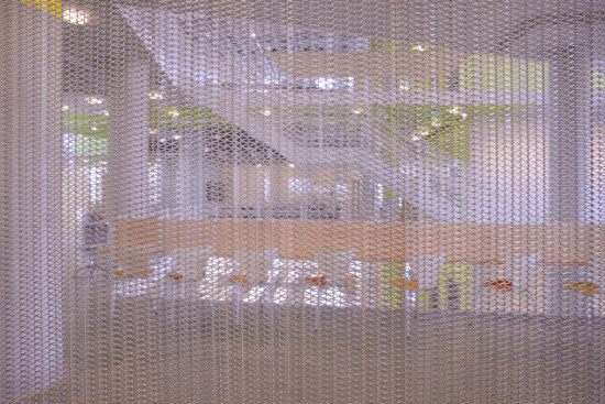 The curtain's triangular mesh pattern is strong and durable, yet flexible. (Courtesy Cambridge Architectural)