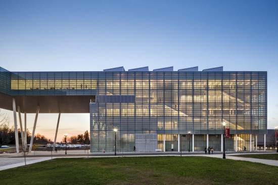 At night, the glass curtain walls allow a glimpse of the activity inside the business school. (Peter Aaron/ESTO)