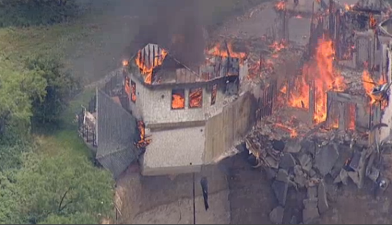 The burning house. (Screenshot via NBC 5 Dallas-Fort Worth)
